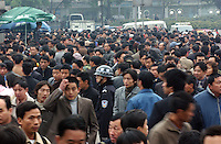 Migrant workers at Guangzhou Railway station prepare to leave Guangdong Province for the Lunat New Year.  Guangdong Province has the largest migrant labor force in south China with milions streaming through the station to the conjested railways..01-FEB-05