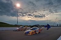 May 20, 2011; Topeka, KS, USA: NHRA funny car driver Ron Capps (near) and Jim Head during qualifying for the Summer Nationals at Heartland Park Topeka. Mandatory Credit: Mark J. Rebilas-