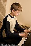Middle School grade 8 music education portrait of boy playing piano vertical