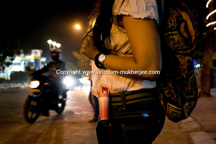 A woman carrying pepper spray while out at night in Kolkata, India. After the Delhi rape case, many women in the metro cities now carry a pepper spray as a means of self defense. Crimes against women have been going on since centuries. In India, women have been categorically marginalized with various types of repressions enforced upon them. Be it home or outside, an Indian woman is potentially at the risk of being discriminated against, molested, raped and even killed. Until recently, turning a blind eye to such crimes has been the norm in largely gender-biased Indian society. But after the brutal gang rape and subsequent death of the Delhi Physiotherapy student, the so-far-silent middle class has turned vocal.