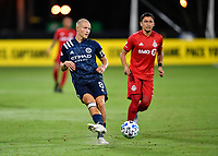 LAKE BUENA VISTA, FL - JULY 26: Alexander Ring of New York City FC passes the ball as Marco Delgado of Toronto FC looks on during a game between New York City FC and Toronto FC at ESPN Wide World of Sports on July 26, 2020 in Lake Buena Vista, Florida.