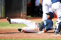 Seattle Mariners minor league infielder Martin Peguero #3 slides into home safely during an instructional league game against the San Diego Padres at the Peoria Sports Complex on October 6, 2012 in Peoria, Arizona.  (Mike Janes/Four Seam Images)