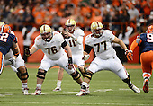 Boston College Eagles lineman Bobby Vardaro (76) and Matt Patchan (77) block for quarterback Chase Rettig (11) during a game against the Syracuse Orange at the Carrier Dome on November 30, 2013 in Syracuse, New York.  Syracuse defeated Boston College 34-31.  (Copyright Mike Janes Photography)