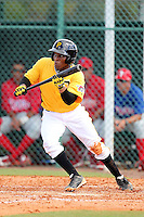 Pittsburgh Pirates shortstop Gift Ngoepe #39 lays down a bunt during an Instructional League game against the Philadelphia Phillies at Pirate City on October 11, 2011 in Bradenton, Florida.  (Mike Janes/Four Seam Images)