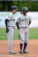 Cedar Rapids Kernels outfielder Byron Buxton #7 and manager Jake Mauer during a game against the Beloit Snappers on May 23, 2013 at Pohlman Field in Beloit, Wisconsin.  Beloit defeated Cedar Rapids 5-3.  (Mike Janes/Four Seam Images)