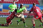 Scarlets lock George Earle tackles Munster flanker Tommy O'Donnell.<br /> Guiness Pro12<br /> Scarlets v Munster<br /> 21.02.15<br /> ©Steve Pope -SPORTINGWALES