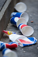Empty drink cups and a sunflower seed package liter the floor of the Gwinnett Braves dugout during the game against the Charlotte Knights at BB&T BallPark on May 22, 2016 in Charlotte, North Carolina.  The Knights defeated the Braves 9-8 in 11 innings.  (Brian Westerholt/Four Seam Images)