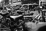 A row of bicycles crowds a sidewalk in  Amsterdam, Netherlands. Feb. 28, 2009.