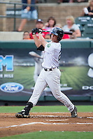 Blake Rutherford (21) of the Pulaski Yankees follows through on his swing against the Elizabethton Twins at Calfee Park on July 25, 2016 in Pulaski, Virginia.  The Twins defeated the Yankees 6-1.  (Brian Westerholt/Four Seam Images)