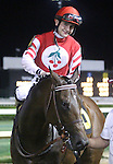 April 26, 2014 Jockey Brian Hernandez Jr. and his horse Embellishing Bob after the Derby Trial at Churchill Downs.  He was the winner by disqualification.  Owner Martin L. Cherry, trainer Steve Margolis