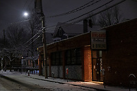"""With its sign dark in the night, American Flatbread (Sacco's Bowl Heaven) is temporarily closed in hibernation due to the ongoing Coronavirus (COVID-19) global pandemic in Davis Square in Somerville, Massachusetts, on Tue., Jan. 26, 2021. A Dec. 15, 2020, announcement from the restaurant states, in part: """"Sadly, we will be joining the many restaurants unable to stay open through the winter.... We'll be posting to remind you that we love you and to announce pop-ups....Without relief, there will be many closures and a lot of businesses will not reopen. We consider ourselves very lucky to have a plan and the opportunity to reopen in the spring."""""""