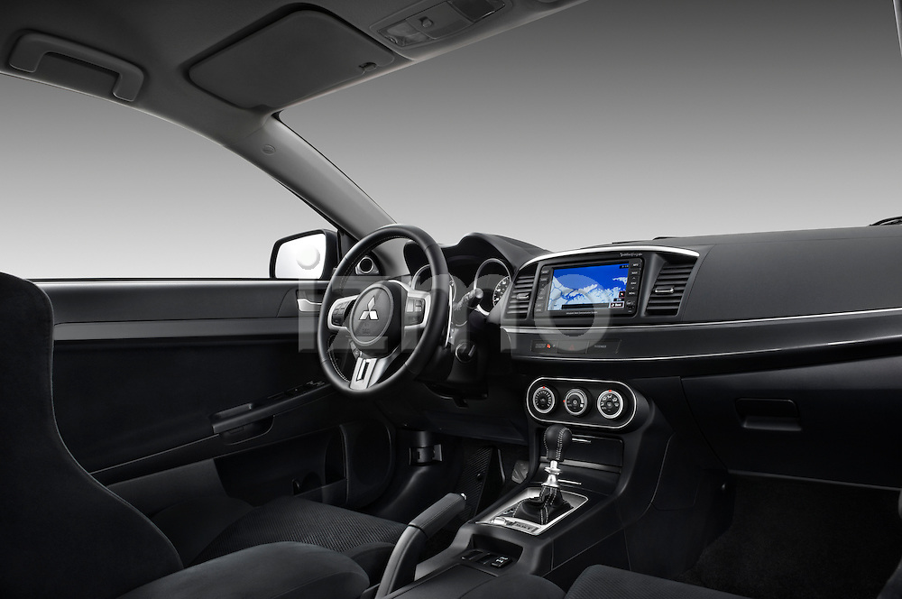Passenger side dashboard view of a 2010 Mitsubishi Lancer Sportback GTS