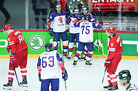 22nd May 2021, Riga Olympic Sports Centre Latvia; 2021 IIHF Ice hockey, Eishockey World Championship, Great Britain versus Russia; 14 Liam Kirk Great Britain scores the first goal for Great Britain at this tournaments and celebrates with 75 Robert Dowd  Matthew Myers and  Dallas Ehrhardt Great Britain.
