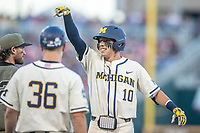 Michigan Wolverines third baseman Blake Nelson (10) on first after a single against the Vanderbilt Commodores during Game 1 of the NCAA College World Series Finals on June 24, 2019 at TD Ameritrade Park in Omaha, Nebraska. Michigan defeated Vanderbilt 7-4. (Andrew Woolley/Four Seam Images)