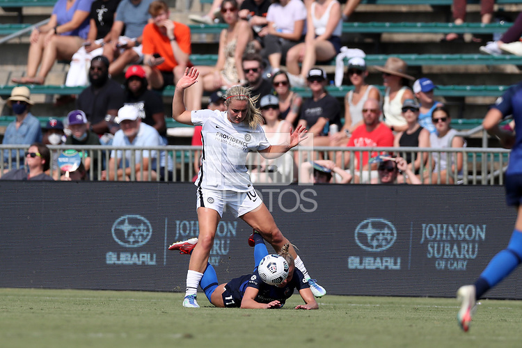 CARY, NC - SEPTEMBER 12: Lindsey Horan #10 of the Portland Thorns FC fouls Merritt Mathias #11 of the North Carolina Courage during a game between Portland Thorns FC and North Carolina Courage at Sahlen's Stadium at WakeMed Soccer Park on September 12, 2021 in Cary, North Carolina.