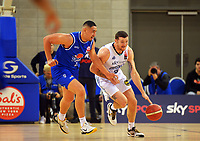 Saints' Taane Samuel (left) and Huskies' Tom Vodanovich in action during the National Basketball League Final Four semifinal match between Wellington Saints and Auckland Huskies at Te Rauparaha Arena in Porirua, New Zealand on Thursday, 22 July 2021. Photo: Dave Lintott / lintottphoto.co.nz