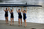 Rowers from Grand Valley carry their boat from the water following a second place finish in the Women's Varsity Heavyweight Eight Division II &III Final during the 68th Dad Vail Regatta on the Schuylkill River in Philadelphia, Pennsylvania on May 13, 2006........