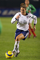 Julie Foudy dribbles the ball during her last soccer match, at the Home Depot Center in Carson, Calif., Tuesday, Dec., 7, 2004.