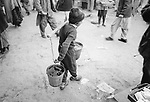 A boy earns a living in transporting water. Safe drinking water and electricity are still lacking throughout Afghanistan, including Kabul, a capital of more than 5 Million. Currently only 23 percent of Afghan households have access to safe drinking water.