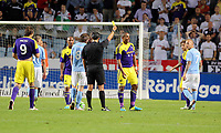 Thursday 08 August 2013<br /> Pictured: Ashley Williams of Swansea (2nd R) is shown a yellow card by matcg referee Serdar Gozubuyuk for his earlier challenge against Pawel Cibicki of Malmo.<br /> Re: Malmo FF v Swansea City FC, UEFA Europa League 3rd Qualifying Round, Second Leg, at the Swedbank Stadium, Malmo, Sweden.
