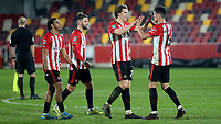 Brentford's Mads Bech Sorensen and Christian Norgaard celebrate their victory at the final whistle during Brentford vs Newcastle United, Carabao Cup Football at the Brentford Community Stadium on 22nd December 2020