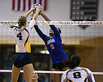 Marymount's Cailyn Thomas jousts at the net in a college volleyball game against St. Mary's, in Lexington Park, MD, on Wednesday, Oct. 29, 2014. Marymount won 3-2 to go 24-9 on the season.<br /> Photo by Cathleen Allison