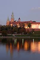 Poland, Krakow, Wawel, Royal Castle, at night, with Vistula River