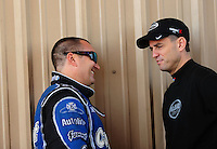Jul. 24, 2011; Morrison, CO, USA: NHRA top fuel dragster driver Brandon Bernstein (left) talks with Larry Dixon during the Mile High Nationals at Bandimere Speedway. Mandatory Credit: Mark J. Rebilas-