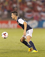 USMNT midfielder Jose Torres (16) collects a pass.  In CONCACAF Gold Cup Group Stage, the U.S. Men's National Team (USMNT) (blue/white) defeated Costa Rica (red/blue), 1-0, at Rentschler Field, East Hartford, CT on July 16, 2013.