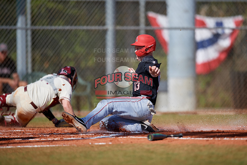 Ball State Cardinals first baseman Griffin Hulecki (13) slides home during a game against the Saint Joseph's Hawks on March 9, 2019 at North Charlotte Regional Park in Port Charlotte, Florida.  Ball State defeated Saint Joseph's 7-5.  (Mike Janes/Four Seam Images)