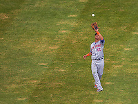 28 July 2013: New York Mets outfielder Juan Lagares pulls in an Adam LaRoche fly ball during a game against the Washington Nationals at Nationals Park in Washington, DC. The Nationals defeated the Mets 14-1. Mandatory Credit: Ed Wolfstein Photo *** RAW (NEF) Image File Available ***