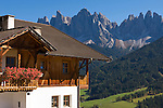 Italy, South Tyrol, Alto Adige, Dolomites, Val di Funes: mountain village St. Magdalena and Le Odle mountains at natural park Puez-Odle, residential building