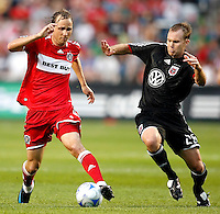 Chicago Fire midfielder Justin Mapp (21) attempts to evade a challenge by DC United defender Bryan Namoff (26).  The DC United defeated the Chicago Fire 2-1 at Toyota Park in Bridgeview, IL on June 7, 2008.