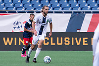 FOXBOROUGH, MA - JULY 4: Marios Lomis #9 of Greenville Triumph SC during a game between Greenville Triumph SC and New England Revolution II at Gillette Stadium on July 4, 2021 in Foxborough, Massachusetts.