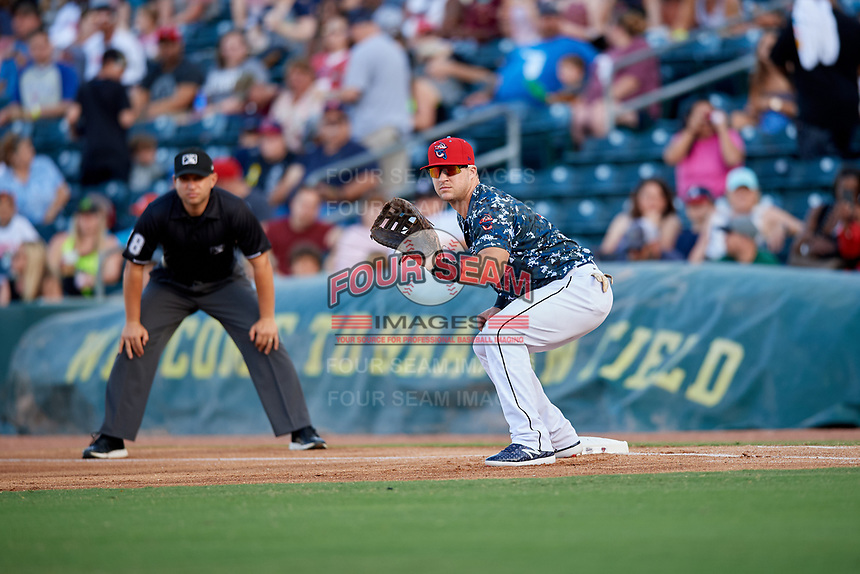 Jacksonville Jumbo Shrimp first baseman Colby Lusignan (7) in front of first base umpire Jonathan Parra during a game against the Mobile BayBears on April 14, 2018 at Baseball Grounds of Jacksonville in Jacksonville, Florida.  Mobile defeated Jacksonville 13-3.  (Mike Janes/Four Seam Images)