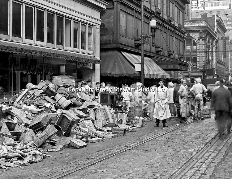 Pittsburgh PA:  View of the flood damage at Diamond and Wood Streets after the flood. About 100,000 buildings were destroyed and the damage was estimated at about $250 million. Sixty-five percent of the downtown business district had been underwater from the Point all the way up to Grant Street.