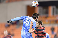 Houston, TX - Friday December 9, 2016: Tucker Hume (36) of the North Carolina Tar Heels wins a header over Tomas Hilliard-Arce (4) of the /sc at the NCAA Men's Soccer Semifinals at BBVA Compass Stadium in Houston Texas.