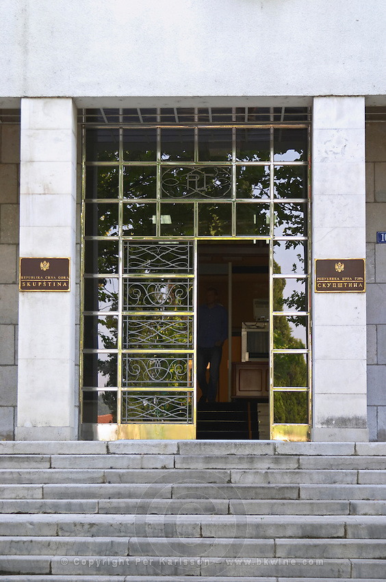 Skupstina Republica Crna Gora, the parliament assembly of Montenegro, main entrance with glass, brass and stone, on the Sveti Petra Saint Peter boulevard. Podgorica capital. Montenegro, Balkan, Europe.