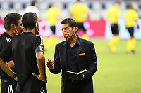 KANSAS CITY, UNITED STATES - AUGUST 25: Tab Ramos Houston Dynamo Head Coach talks with his assistants at half time  a game between Houston Dynamo and Sporting Kansas City at Children's Mercy Park on August 25, 2020 in Kansas City, Kansas.