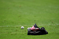 Rawlings baseball bag and baseballs sit in the outfield grass before a game between the FCL Orioles Orange and FCL Braves on July 22, 2021 at the CoolToday Park in North Port, Florida.  (Mike Janes/Four Seam Images)