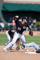 Erie SeaWolves shortstop Eugenio Suarez (27) attempts to turn a double play during a game against the Akron RubberDucks on May 18, 2014 at Jerry Uht Park in Erie, Pennsylvania.  Akron defeated Erie 2-1.  (Mike Janes/Four Seam Images)