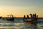 Fisherman going night fishing Ngapali Beach. Burma Myanmar  2008