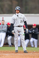 Charlie Morgan (24) of the Wake Forest Demon Deacons looks to his third base coach for the sign against the Davidson Wildcats at Wilson Field on March 19, 2014 in Davidson, North Carolina.  The Wildcats defeated the Demon Deacons 7-6.  (Brian Westerholt/Four Seam Images)