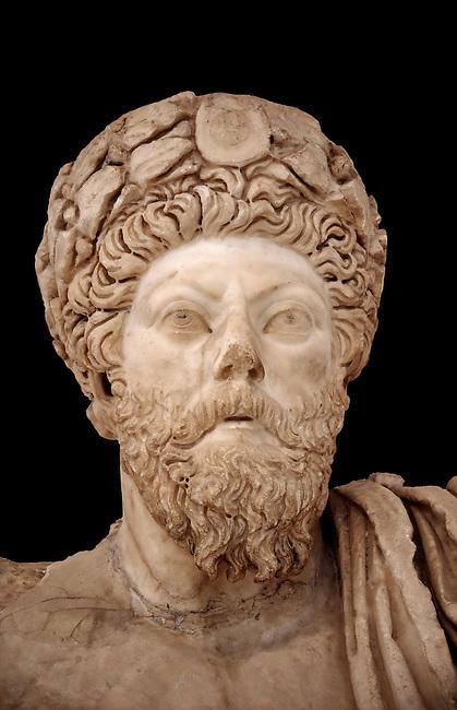 Roman sculpture of the Emperor Marcus Aurelius, excavated from Bulla Regia Theatre, sculpted circa late second century. The Bardo National Museum, Tunis.  Against a black background.