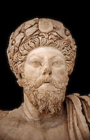 Roman sculpture of the Emperor Marcus Aurelius, excavated from Bulla Regia Theatre, sculpted circa late second century. The Bardo National Museum, Tunis.  Against a black background.