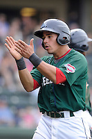 Catcher Jayson Hernandez (12) of the Greenville Drive claps his hands after scoring a run in a game against the Charleston RiverDogs on Sunday, May 19, 2013, at Fluor Field at the West End in Greenville, South Carolina. Charleston won, 9-7. (Tom Priddy/Four Seam Images)