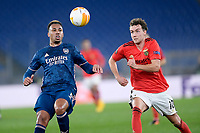 18th February 2021, Rome, Italy;  Gabriel Magalhaes of Arsenal FC competes for the ball with Luca Waldschmidt during the UEFA Europa League round of 32 Leg 1 match between SL Benfica and Arsenal at Stadio Olimpico, Rome, Italy on 18 February 2021.
