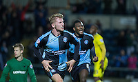 Jason McCarthy of Wycombe Wanderers celebrates his winning goal during the Sky Bet League 2 match between Wycombe Wanderers and Oxford United at Adams Park, High Wycombe, England on 19 December 2015. Photo by Andy Rowland.