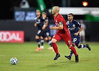 LAKE BUENA VISTA, FL - JULY 26: Michael Bradley of Toronto FC looks for options as he dribbles the ball away from Maximillano Moralez of New York City FC during a game between New York City FC and Toronto FC at ESPN Wide World of Sports on July 26, 2020 in Lake Buena Vista, Florida.