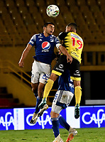 BOGOTA - COLOMBIA, 15-11-2020: Jhon Duque de Millonarios F. C. y Cesar Arias de Alianza Petrolera disputan el balon, durante partido entre Millonarios F. C. y Alianza Petrolera de la fecha 20 por la Liga BetPlay DIMAYOR 2020 jugado en el estadio Nemesio Camacho El Campin de la ciudad de Bogota. / Jhon Duque of Millonarios F. C. and Cesar Arias of Alianza Petrolera figth for the ball, during a match between Millonarios F. C. and Alianza Petrolera of the 20th date for the BetPlay DIMAYOR League 2020 played at the Nemesio Camacho El Campin Stadium in Bogota city. / Photo: VizzorImage / Luis Ramirez / Staff.